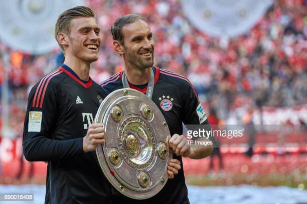 Goalkeeper Leo Weinkauf of Bayern Muenchen and Goalkeeper Tom Starke of Bayern Muenchen poses with the Championship trophy in celebration of the 67th...