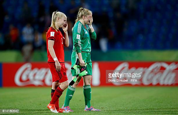 Goalkeeper Leonie Doege of Germany and team mate Caroline Siems show their frustration after losing the FIFA U17 Women's World Cup Quarter Final...