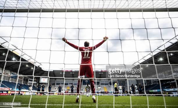 Goalkeeper Leopold Zingerle of Paderborn waits for the penalty of Lars Stindl of Mönchengladbach during the Bundesliga match between SC Paderborn 07...
