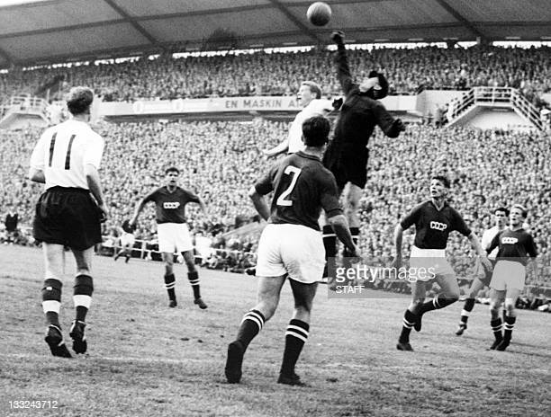 Goalkeeper Lev Yashin from the Soviet Union boxes the ball away from an English player during the World Cup first round soccer match between the...