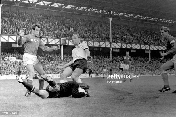 USSR goalkeeper Lev Yashin saves at the feet of West Germany's Uwe Seeler as teammates Vasily Danilov and Albert Shesterniev look on