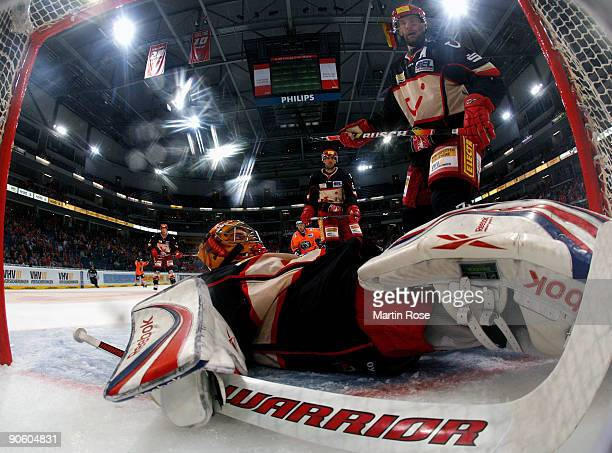 Goalkeeper Levente Szuper of Hannover lies dejected on the ice during the DEL match between Hannover Scorpions and EHC Wolfsburg at the TUI Arena on...