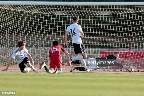 Goalkeeper Lino Kasten of Germany U17 defends a ball when chalenged by Bernardo Silva oposed by defenders Jonas Kehl and Antonis Aidonis the of...