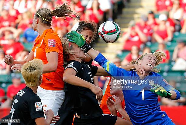 Goalkeeper Loes Geurts of Netherlands defends a corner kick against Hannah Wilkinson and Amber Hearn of New Zealand during the FIFA Women's World Cup...
