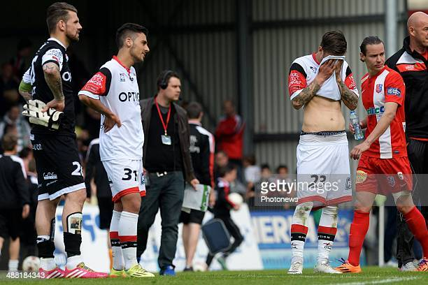 goalkeeper Logan Bailly of OH Leuven Ben Yagan of OH Leuven and Ivan Bandalovski of OH Leuven show dejection during match day 1 of the Final Round in...