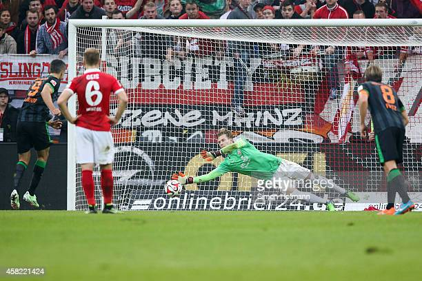 Goalkeeper Loris Karius of Mainz saves a penalty shot of Franco di Santo of Bremen during the Bundesliga match between 1. FSV Mainz 05 and SV Werder...