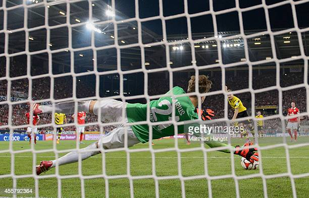 Goalkeeper Loris Karius of Mainz saves a penaltykick of Ciro Immobile of Dortmund during the Bundesliga match between 1 FSV Mainz 05 and Borussia...