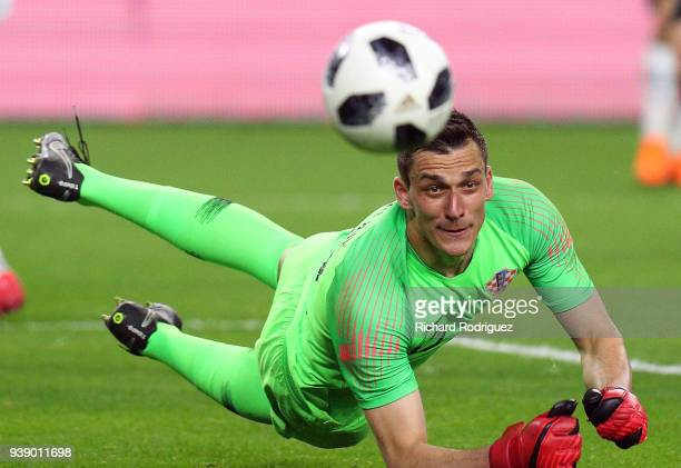 Goalkeeper Lovre Kalinic of Croatia watches the ball after knocking away a shot by Mexico in the second half of an international friendly soccer...