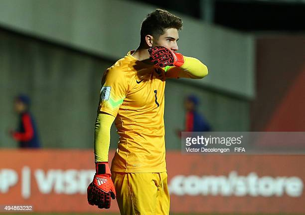 Goalkeeper Luca Zidane of France bites the tape on his glove after France lost to Costa Rica 53 by penalty kick shootout in the France v Costa Rica...