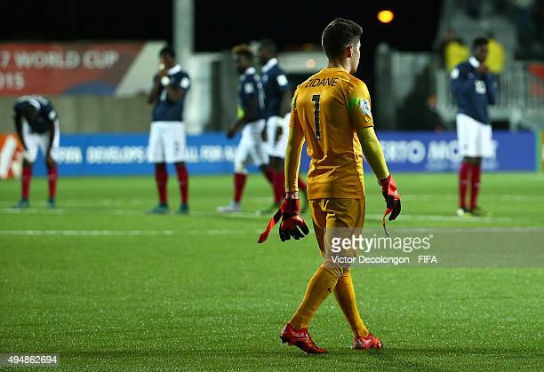 Goalkeeper Luca Zidane of France walks toward his teammates after they lost to Costa Rica 53 in a penalty kick shootout in the France v Costa Rica...