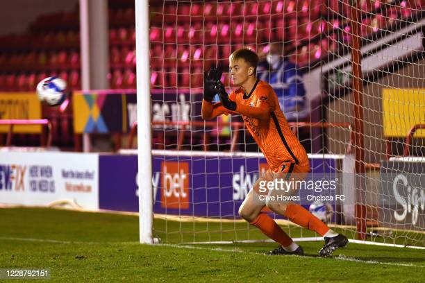Goalkeeper Lucas Bergstrom of Chelsea saves a penalty in the penalty shootout during the Chelsea Development Squad v Walsall EFL Trophy match at...