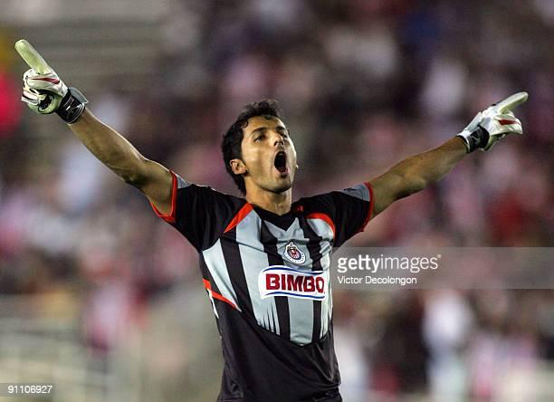 Goalkeeper Luis Michel of Chivas de Guadalajara celebrates the second goal of teammate Omar Arellano in the second half during the International Club...