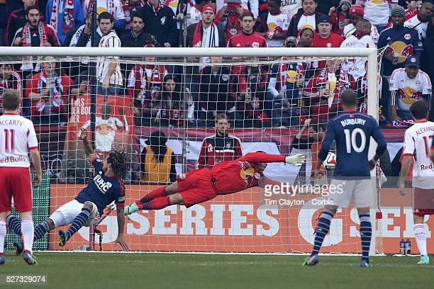Goalkeeper Luis Robles makes a great save from a Jermaine Jones header during the New York Red Bulls Vs New England Revolution MLS Eastern Conference...