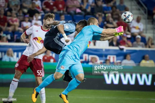 Goalkeeper Luis Robles of New York Red Bulls blocks the advance by Vancouver Whitecaps FC during the MLS match between New York Red Bulls and...