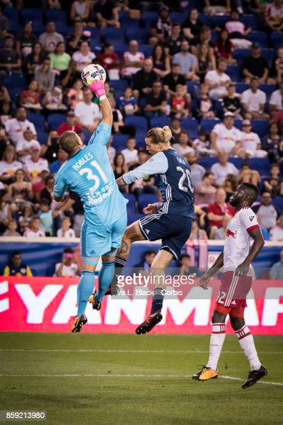 Goalkeeper Luis Robles of New York Red Bulls blocks the shot by Brek Shea of the Vancouver Whitecaps FC during the MLS match between New York Red...