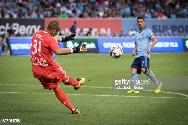 Goalkeeper Luis Robles of New York Red Bulls clears the ball from Captain David Villa of New York City FC during the MLS match between the New York...