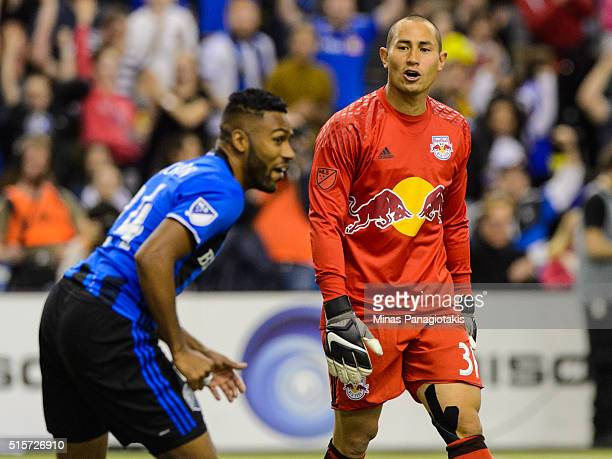Goalkeeper Luis Robles of the New York Red Bulls watches Anthony JacksonHamel of the Montreal Impact celebrate his goal during the MLS game at the...