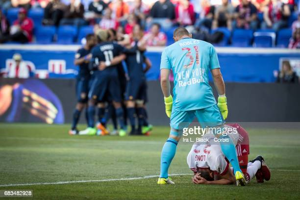 Goalkeeper Luis Robles of the NY Red Bulls stands over an injured teammate Aaron Long after Romain Alessandrini of the LA Galaxy scored another goal...