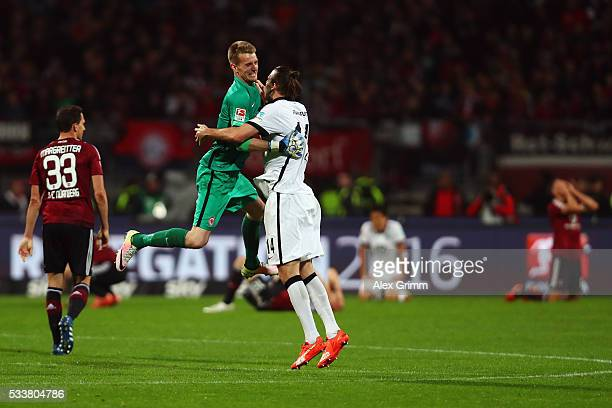 Goalkeeper Lukas Hradecky anf Alexander Meier of Frankfurt celebrate after the Bundesliga Playoff Leg 2 between 1 FC Nuernberg and Eintracht...