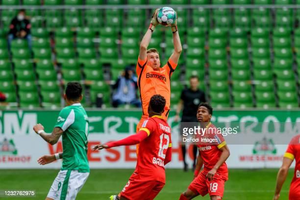 Goalkeeper Lukas Hradecky of Bayer 04 Leverkusen controls the ball during the Bundesliga match between SV Werder Bremen and Bayer 04 Leverkusen at...