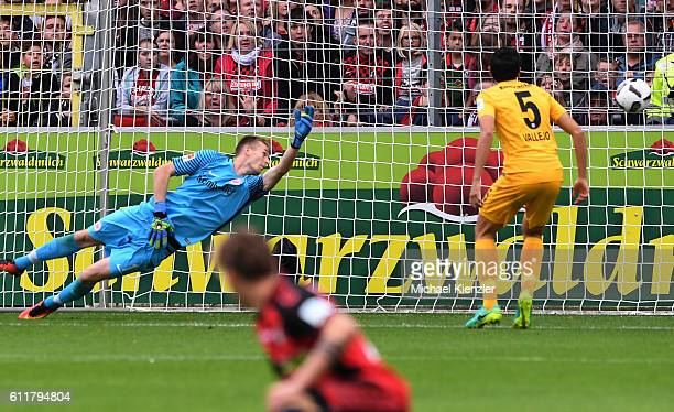 Goalkeeper Lukas Hradecky of Eintracht Frankfurt scores the opening goal of Freiburgs Vincenzo Grifo during the Bundesliga match between Sport Club...