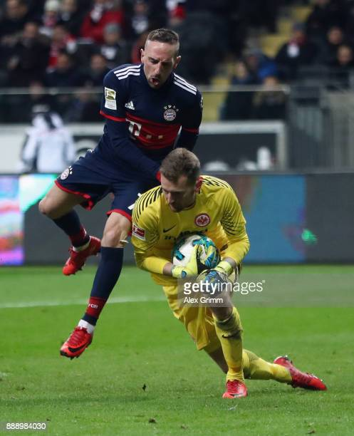 Goalkeeper Lukas Hradecky of Frankfurt is challenged by Franck Ribery of Muenchen during the Bundesliga match between Eintracht Frankfurt and FC...
