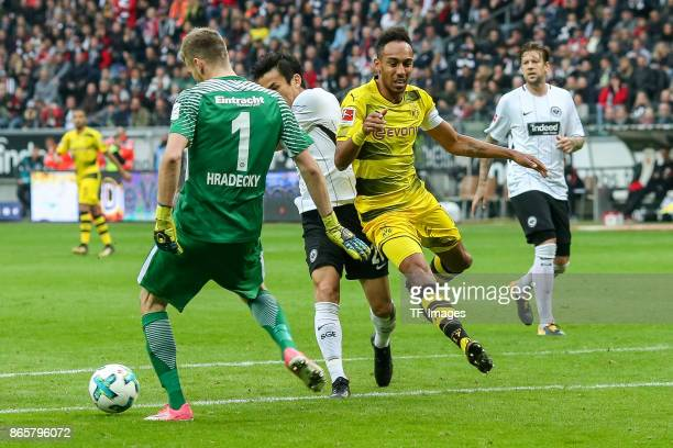 Goalkeeper Lukas Hradecky of Frankfurt Makoto Hasebe of Frankfurt and PierreEmerick Aubameyang of Dortmund battle for the ball during the Bundesliga...