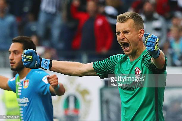 Goalkeeper Lukas Hradecky of Frankfurt reacts after saving a penalty from Javier Hernandez of Leverkusen during the Bundesliga match between...