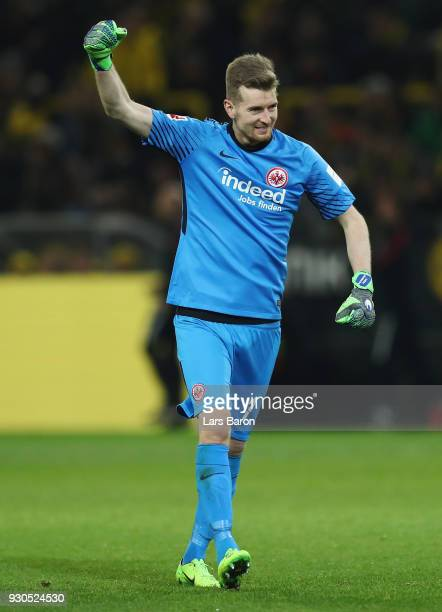 Goalkeeper Lukas Hradecky of Frankfurt reacts after team mate Luka Jovic scored their team's first goal during the Bundesliga match between Borussia...