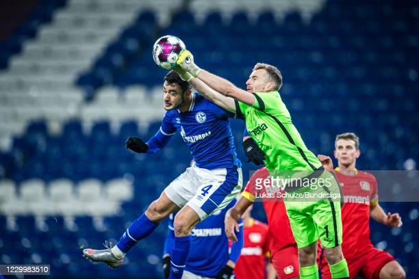 Goalkeeper Lukas Hradecky of Leverkusen safes a ball against Ozan Kabak of Schalke during the Bundesliga match between FC Schalke 04 and Bayer 04...