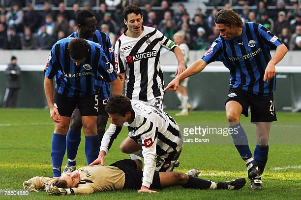 Goalkeeper Lukas Kruse of Paderborn lies injured on the pitch after a tackle of Rob Friend of Moenchengladbach during the 2nd Bundesliga match...