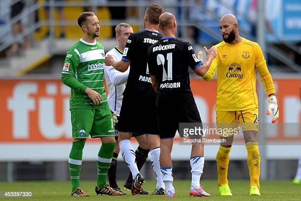Goalkeeper Lukas Kruse of Paderborn Tony Hibbert of Everton Christian Strohdiek of Paderborn Daniel Brueckner of Paderborn and goalkeeper Tim Howard...