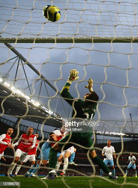 Goalkeeper Lukasz Fabianski of Arsenal is helpless as Richard Dunne of Aston Villa scores their first goal with a header during the FA Cup with...