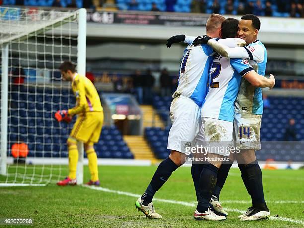 Goalkeeper Lukasz Fabianski of Swansea City looks dejected as Craig Conway of Blackburn Rovers celebrates with Jordan Rhodes and Marcus Olsson as he...