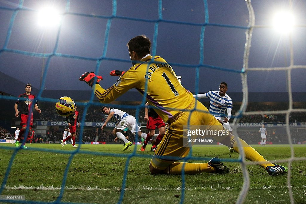 Goalkeeper Lukasz Fabianski of Swansea City saves the header from Joey Barton of QPR during the Barclays Premier League match between Queens Park Rangers and Swansea City at Loftus Road on January 1, 2015 in London, England.