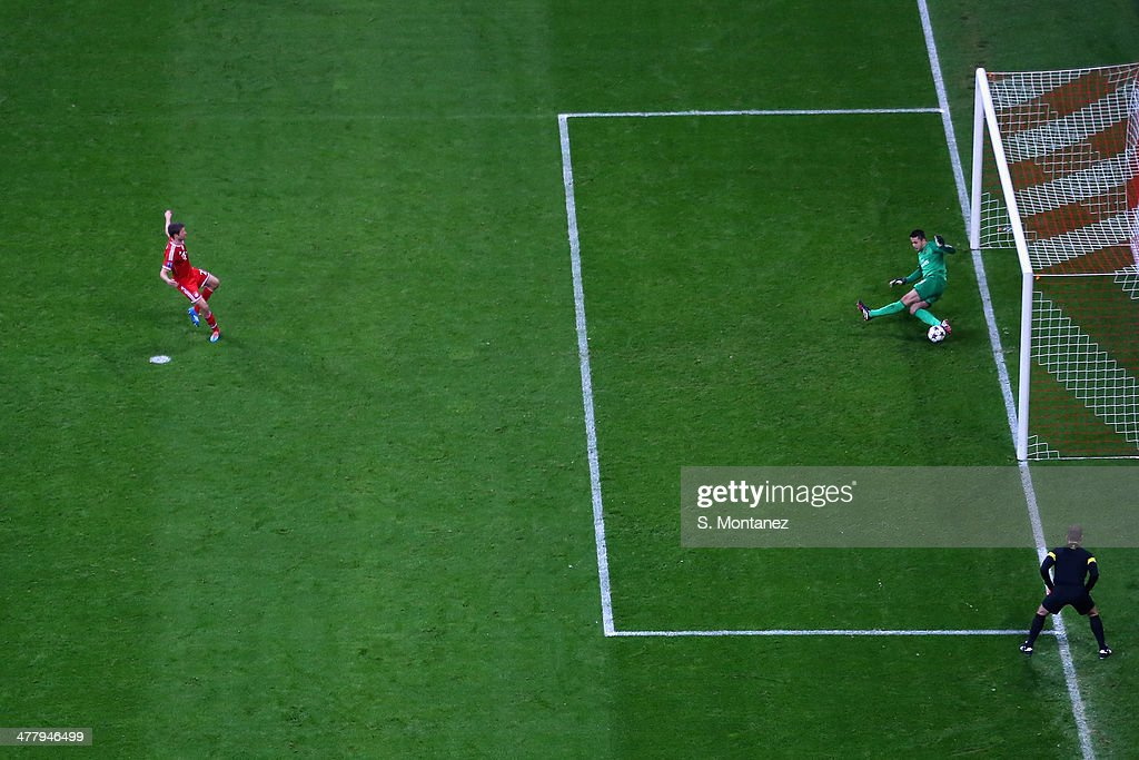 Goalkeeper Lukasz Fabienski of Arsenal saves a penalty shot by Thomas Mueller of Bayern Munich during the UEFA Champions League Round of 16 second leg match between FC Bayern Muenchen and Arsenal at Allianz Arena on March 11, 2014 in Munich, Germany.