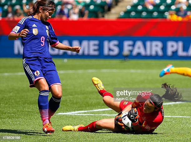Goalkeeper Lydia Williams of Australia saves a shot on goal by Japan during the FIFA Women's World Cup Canada 2015 Quarter Final match between...