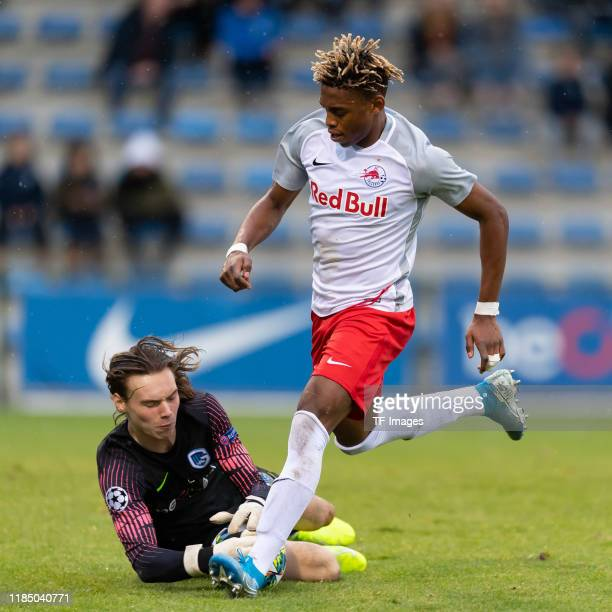 Goalkeeper Maarten Vandevoordt of KRC Genk U19 and Chukwubuike Adamu of RB Salzburg U19 battle for the ball during the UEFA Youth League match...