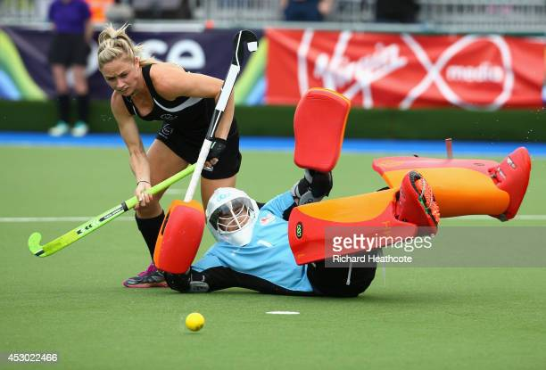 Goalkeeper Maddie Hinch of England saves from Anita Punt of New Zealand in the penalty shuttles to put England through to the Gold Medal final during...