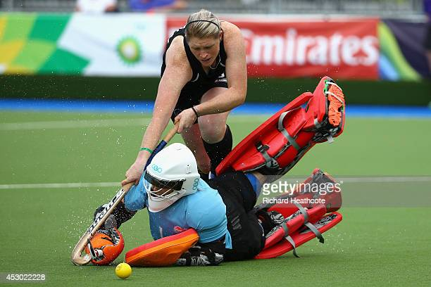 Goalkeeper Maddie Hinch of England saves from Katie Glynn of New Zealand in the penalty shuttles to put England through to the Gold Medal final...