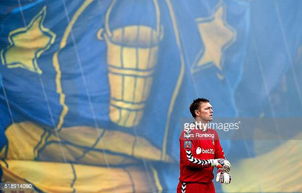 Goalkeeper Mads Toppel of Brondby IF prepares his gloves j front of the Brondby fans tide prior to the Danish Alka Superliga match between FC...