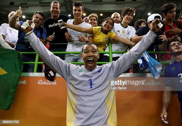 Goalkeeper Maik dos Santos of Brazil celebrates with fans after winning the Mens Preliminary Group B match between Brazil and Germany at Future Arena...
