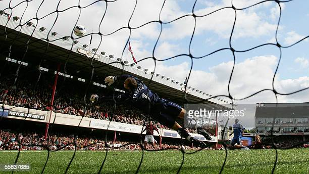 Goalkeeper Maik Taylor of Birmingham City dives full length to save a shot from Fredrik Ljungberg of Arsenal during the Barclays Premiership match...