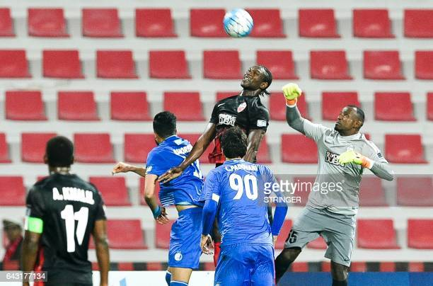 Goalkeeper Majed Naser of UAE's AlAhli FC tries to punch the ball during the AFC Champions League qualifying football match between UAE's AlAhli and...