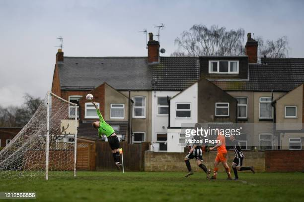 Goalkeeper makes a save during Sunday league football between Syston Brookside FC and Shepshed Oaks FC on March 15, 2020 in Leicester, England.