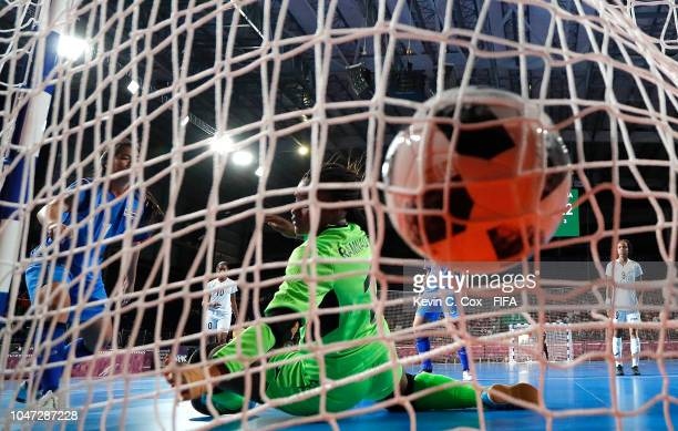 Goalkeeper Makida Herbert of Trinidad Tobago allows a goal to be scored by Thidarat Sribunhom of Thailand in the Women's Group C match between...