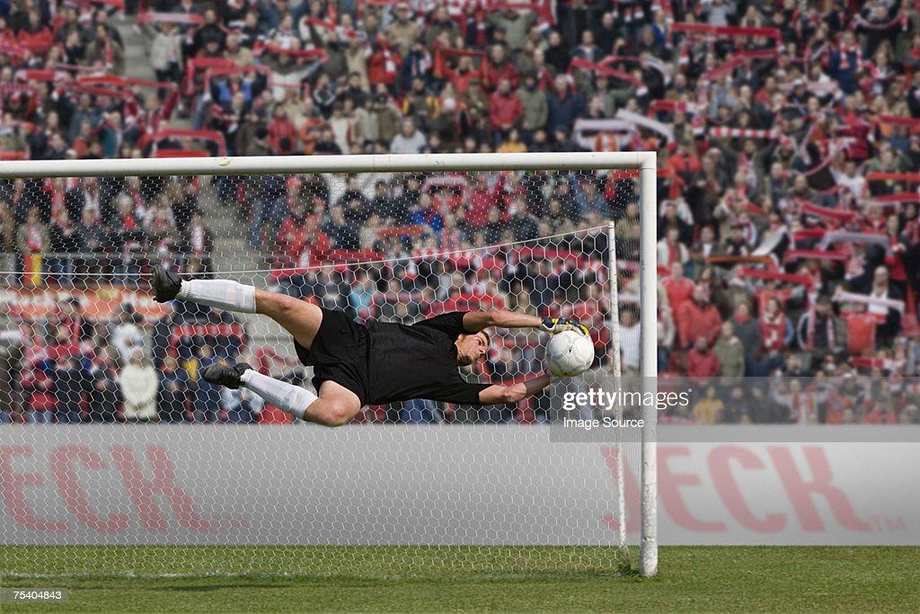 Goalkeeper making a save : Stock Photo