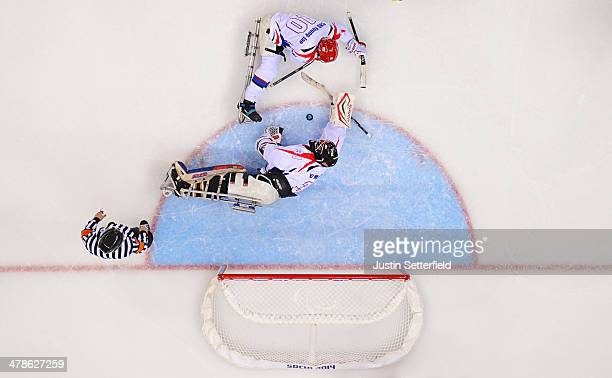 Goalkeeper ManGyun Yu and defender YoungJae Cho of Korea stop Sweden from scoring during the Ice Sledge Hockey classification game between Korea and...
