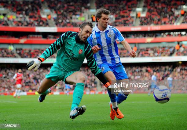 Goalkeeper Manuel Almunia of Arsenal and Anthony Pilkington of Huddersfield battle for the ball during the FA Cup sponsored by E.ON fourth round...