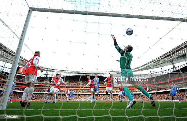 Goalkeeper Manuel Almunia of Arsenal fails to save the header from Alan Lee of Huddersfield to level the scores at 11 during the FA Cup sponsored by...